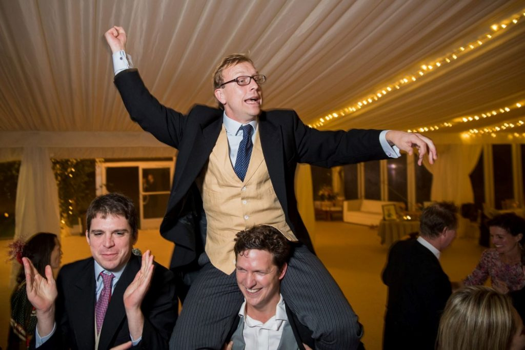 guest carried shoulder high marquee reception blenheim palace venue woodstock oxfordshire oxford wedding photographer