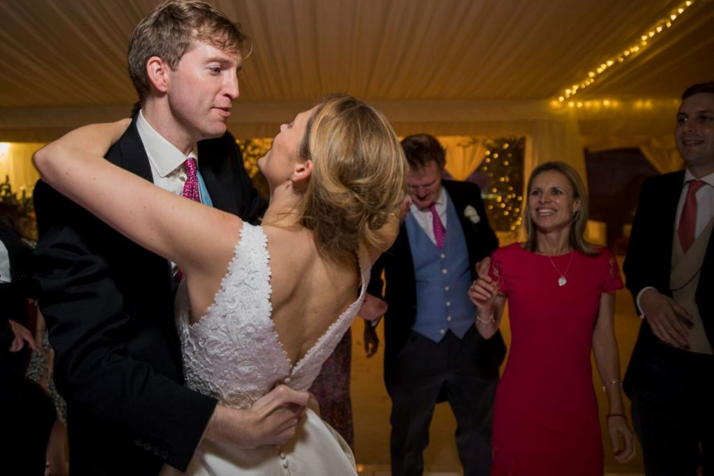 bride groom dance closely marquee reception blenheim palace woodstock oxfordshire oxford wedding photographers