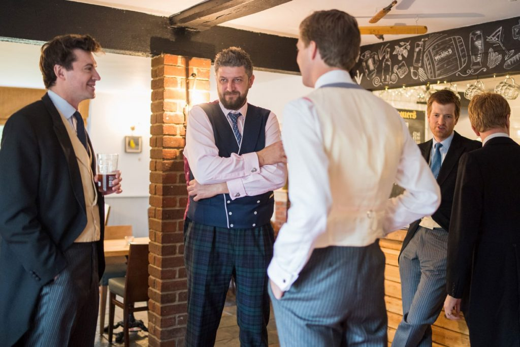 groom groomsmen drink before ceremony church of st michael aston tirrold oxford wedding photography