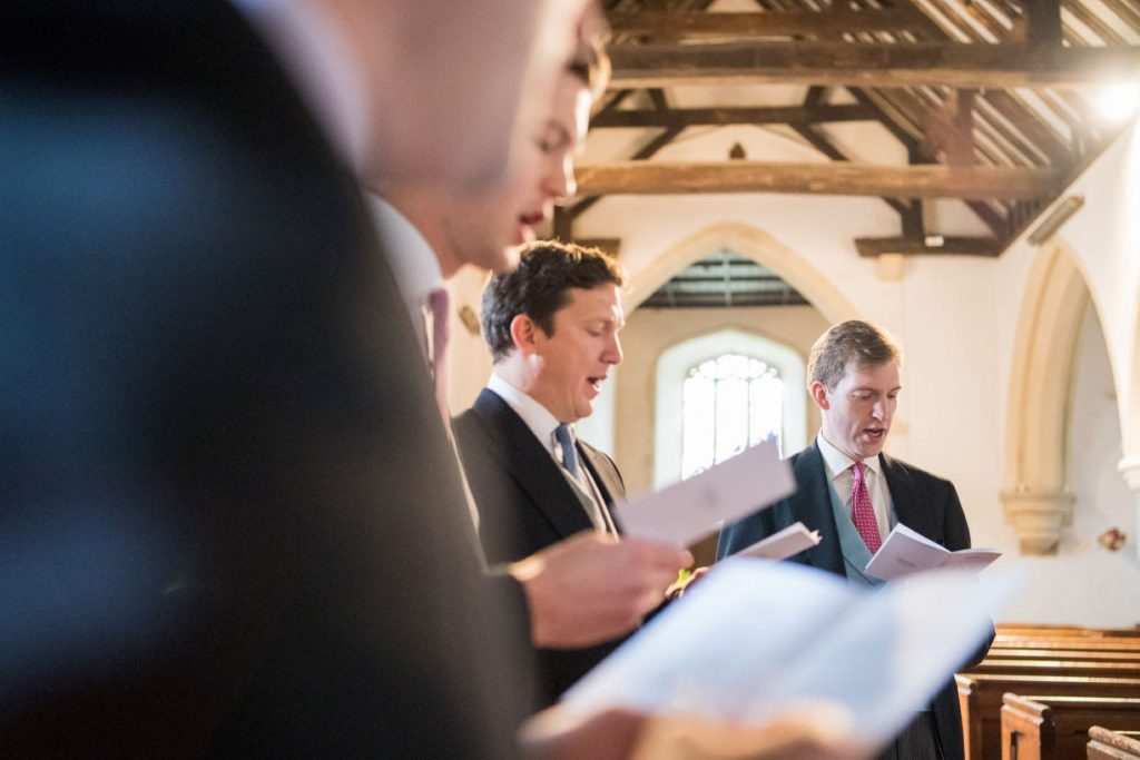 groom groomsmen sing church of st michael aston tirrold oxfordshire oxford wedding photographers