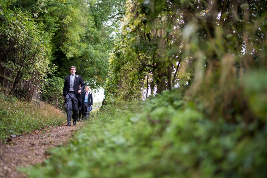groom groomsmen walk to ceremony church of st michael aston tirrold oxfordshire oxford wedding photography