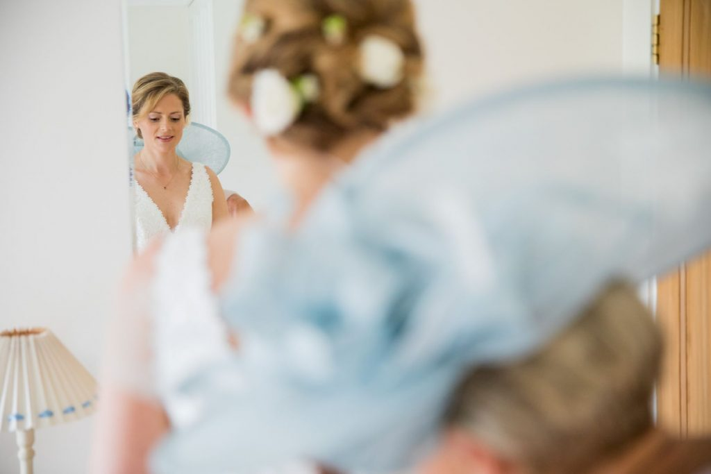 brides dress mirror reflection church of st michael ceremony aston tirrold oxfordshire oxford wedding photographers