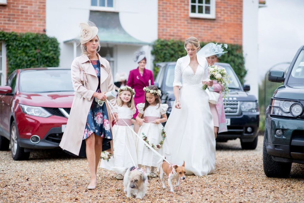 bridal party leave brides home church of st michael ceremony aston tirrold oxfordshire wedding photographers