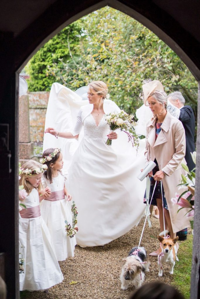 archway frames bridal party church of st michael ceremony aston tirrold oxfordshire oxford wedding photography