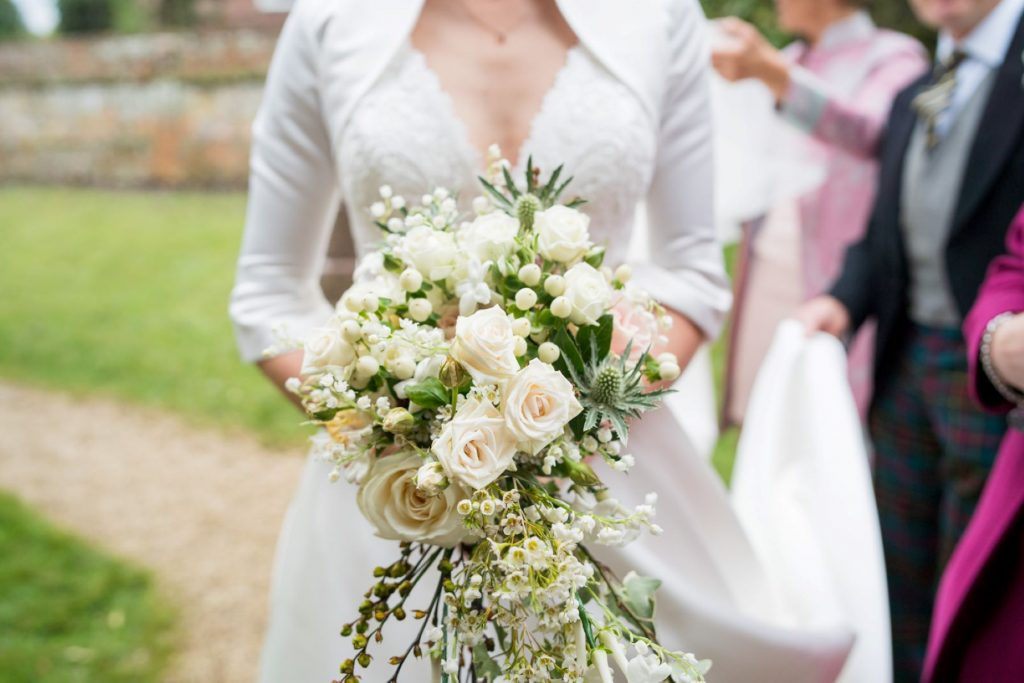 brides floral bouquet church of st michael churchyard aston tirrold oxfordshire wedding photographers
