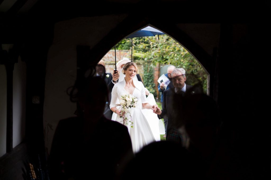 bride with father enter church of st michael aston tirrold oxfordshire oxford wedding photographer