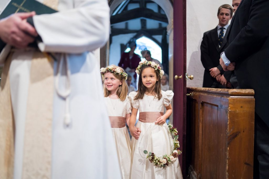 vicar flowergirls enter church of st michael ceremony aston tirrold oxfordshire oxford wedding photography