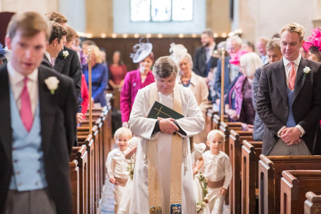 vicar pageboys walk down aisle church of st michael ceremony aston tirrold oxfordshire wedding photographer