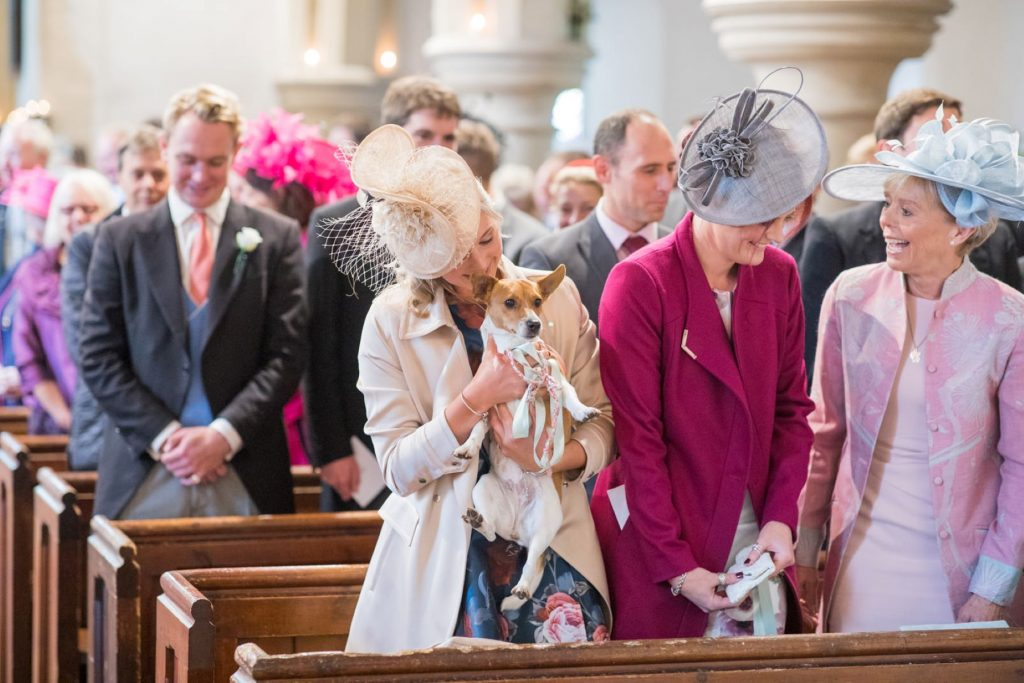 brides relatives with dog await brides ceremony entrance church of st michael aston tirrold oxfordshire wedding photography
