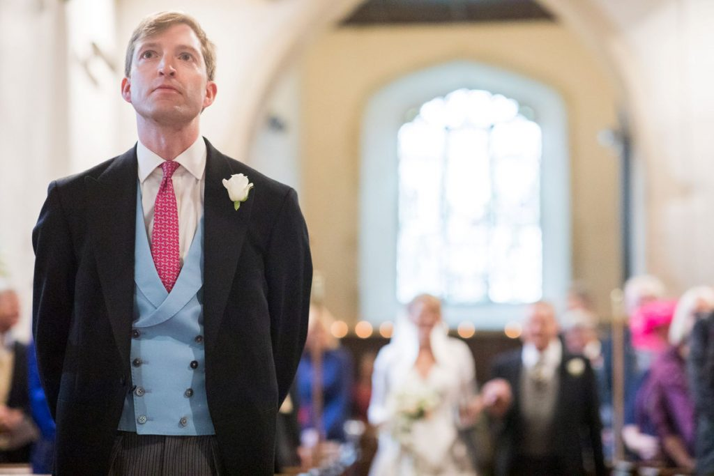 groom awaits bride with father church of st michael ceremony aston tirrold oxfordshire oxford wedding photographers