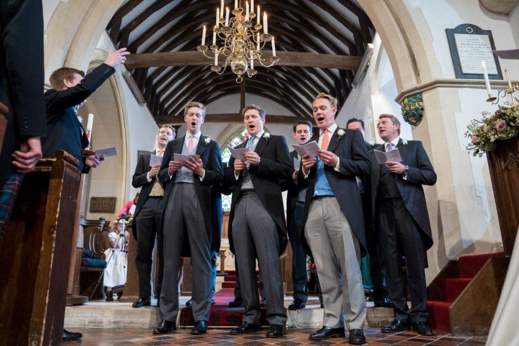 singing groomsmen church of st michael aston tirrold oxfordshire oxford wedding photographer
