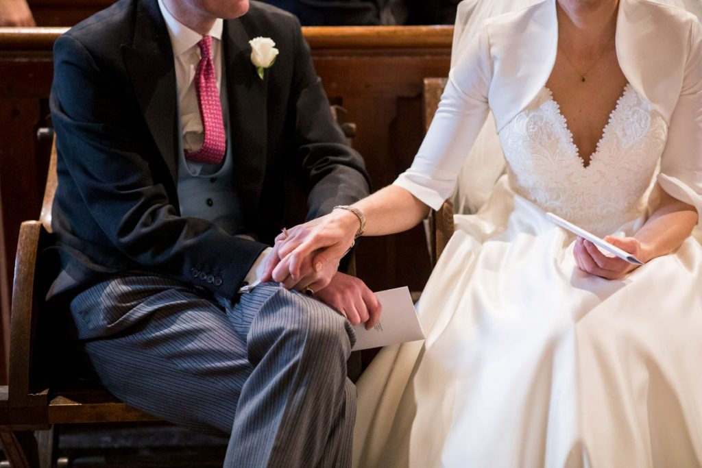 bride groom hold hands church of st michael ceremony aston tirrold oxford wedding photographers