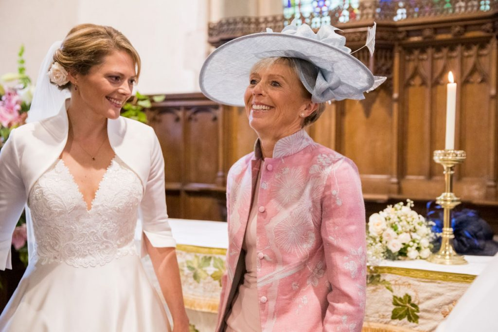smiling bride with mother church of st michael aston tirrold oxfordshire oxford wedding photographer