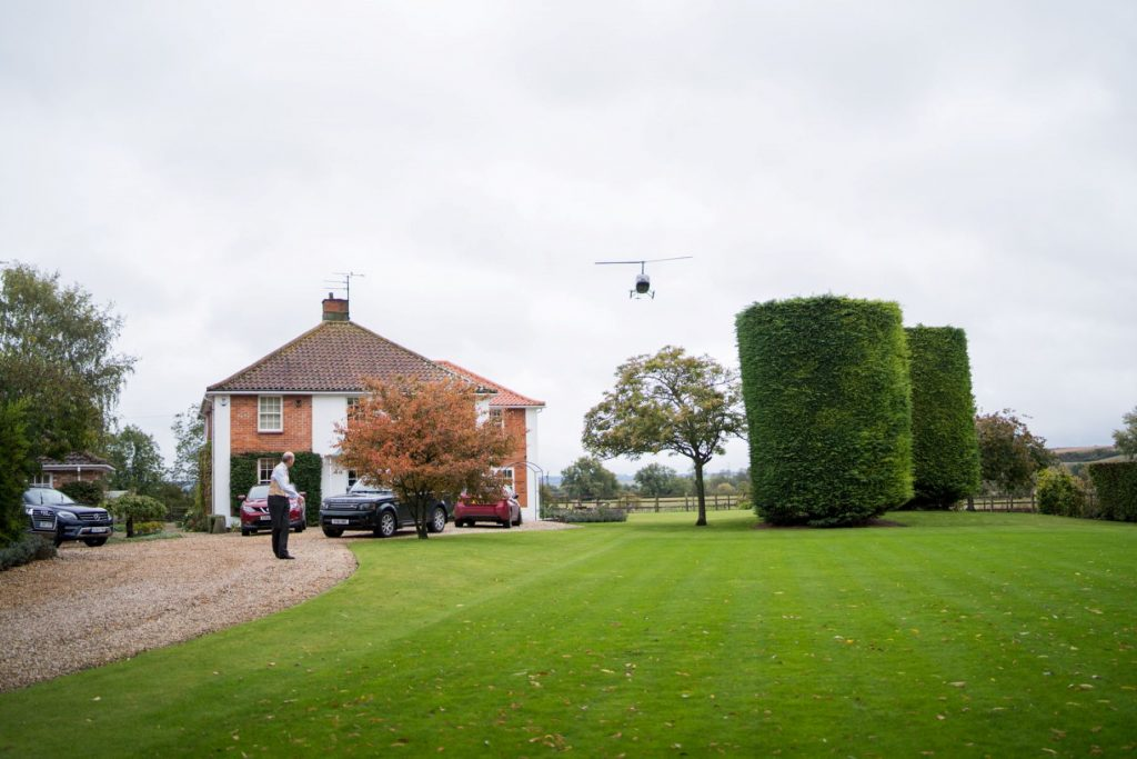 brides helicopter arrives church of st michael ceremony aston tirrold oxfordshire wedding photographers
