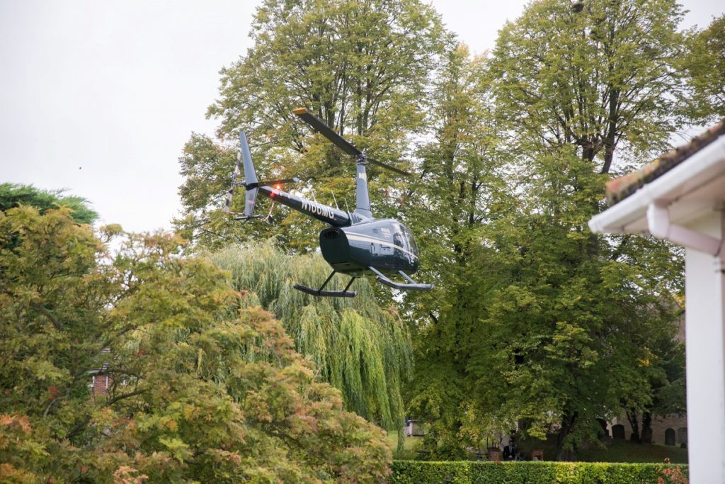 helicopter approaches brides home church of st michael ceremony aston tirrold oxfordshire oxford wedding photographers
