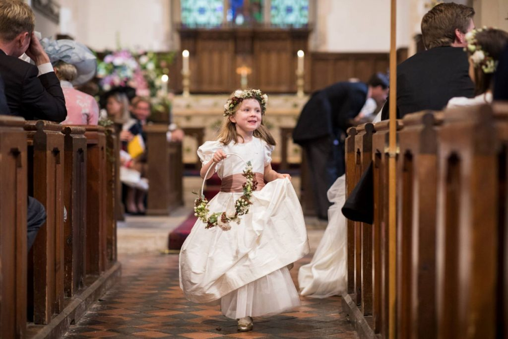 flowergirl runs down aisle church of st michael aston tirrold oxfordshire oxford wedding photography