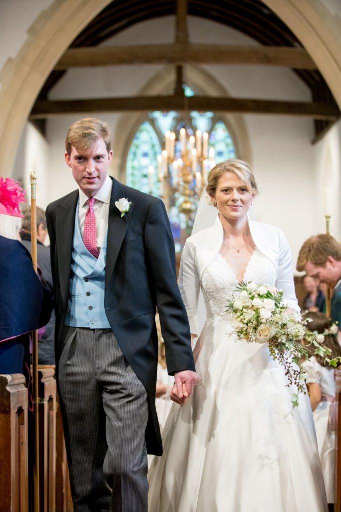 bride groom walk down aisle church of st michael aston tirrold oxfordshire wedding photographers