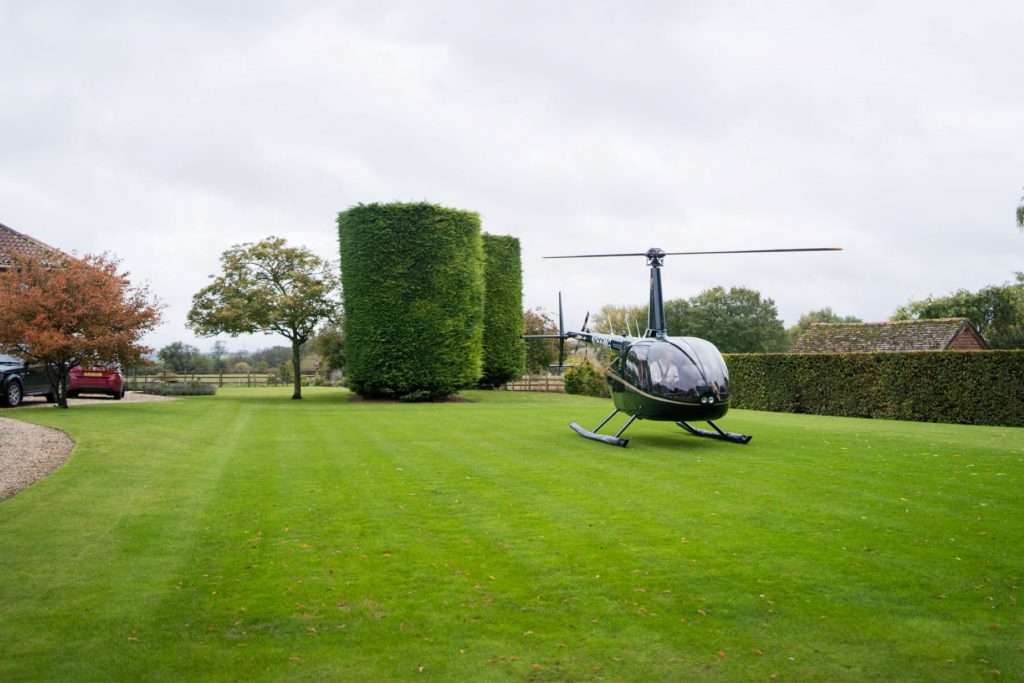 helicopter lands brides garden church of st michael aston tirrold ceremony oxfordshire wedding photography