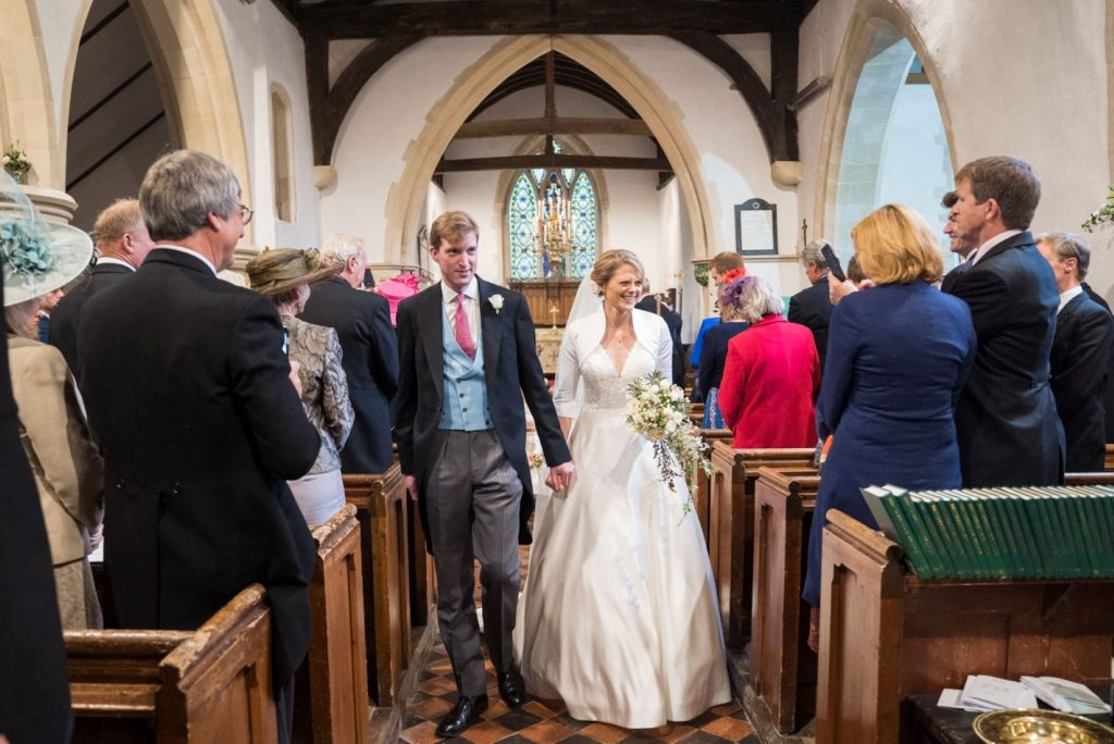 smiling bride groom walk down aisle church of st michael aston tirrold oxfordshire oxford wedding photographer