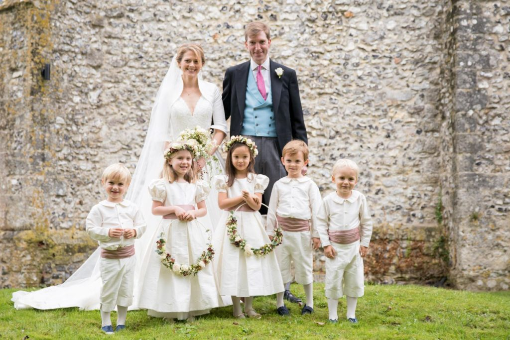 bride groom flowergirls pageboys portrait church of st michael churchyard aston tirrold oxfordshire wedding photographer