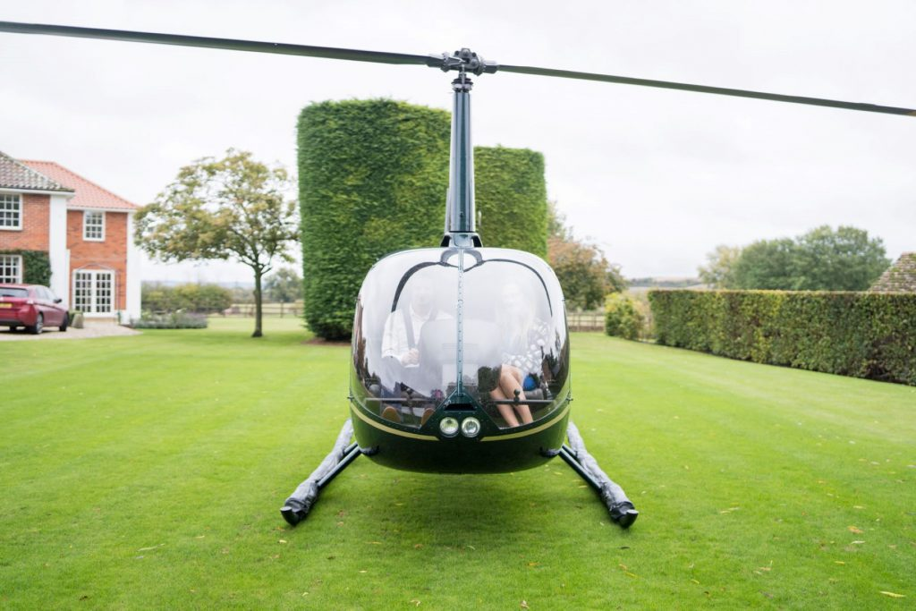 helicoper awaits bride groom church of st michael ceremony aston tirrold oxfordshire wedding photographers