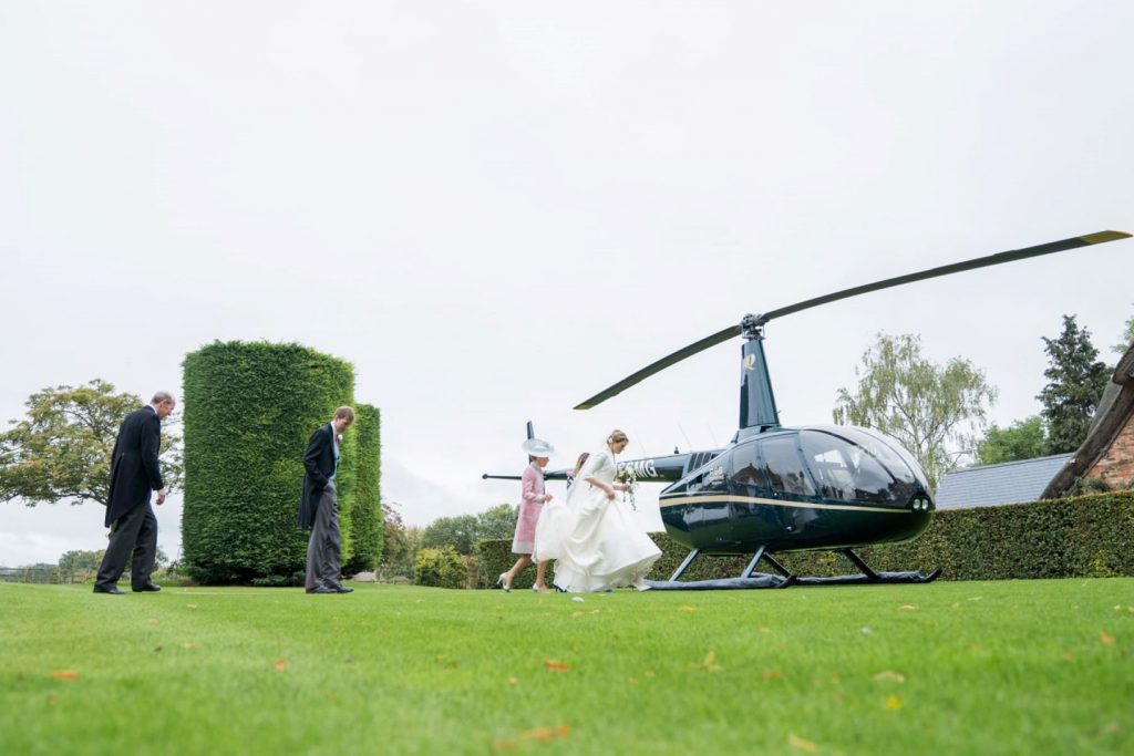 bride groom board helicopter for blenheim palace venue woodstock oxfordshire oxford wedding photographer