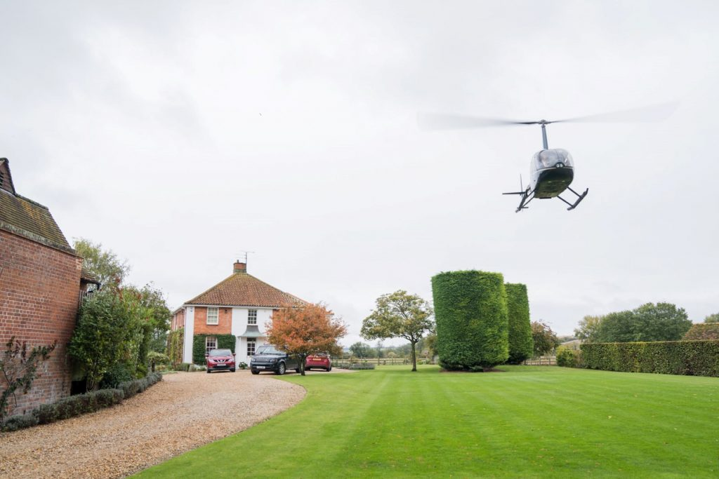 bride grooms helicopter leaves for blenheim palace venue woodstock oxfordshire oxford wedding photographers