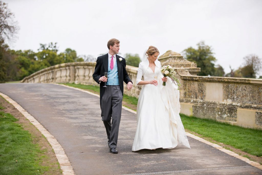 bride groom stroll over bridge blenheim palace grounds woodstock oxfordshire wedding photographers