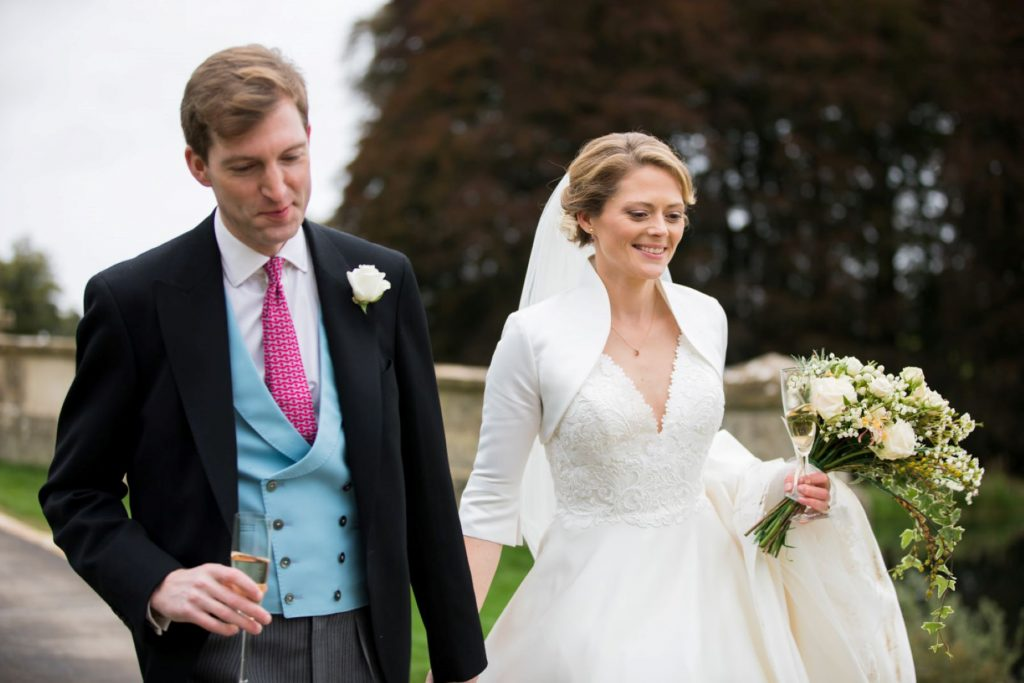 groom bride with bouquet blenheim palace grounds woodstock oxfordshire wedding photography