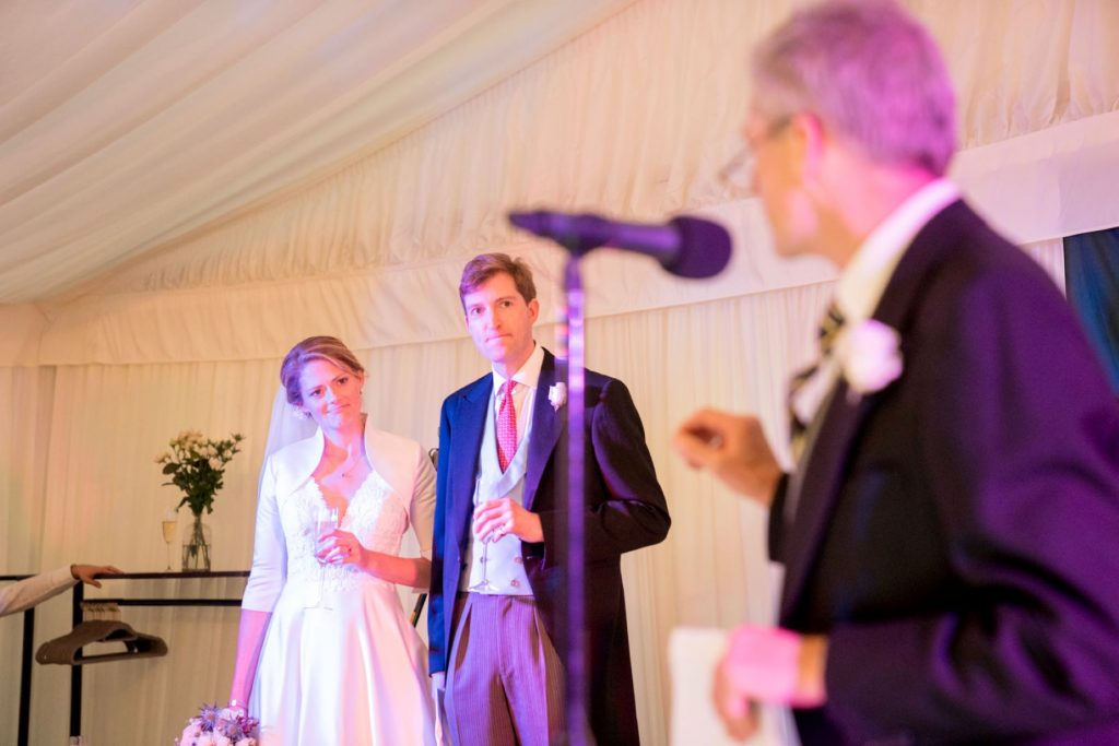 bride groom hear father of bride speech marquee reception blenheim palace woodstock oxfordshire wedding photographers