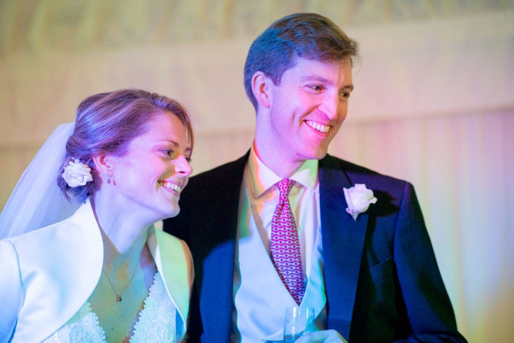 smiling bride groom marquee champagne reception blenheim palace venue woodstock oxfordshire oxford wedding photographer
