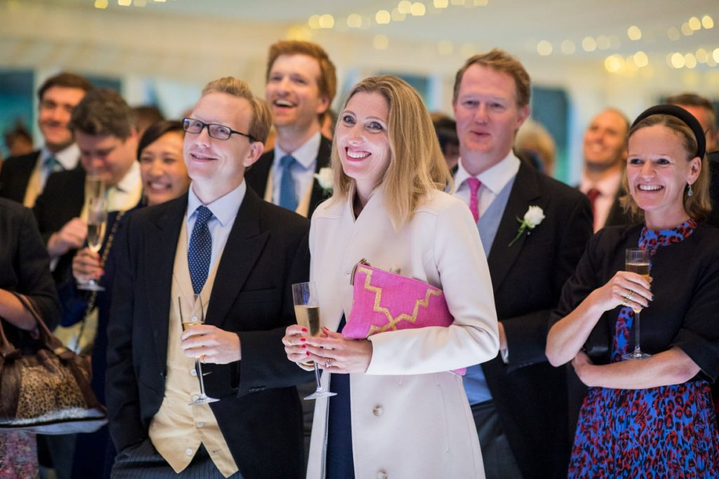 smiling guests hear speeches champagne marquee reception blenheim palace venue woodstock oxfordshire oxford wedding photographers