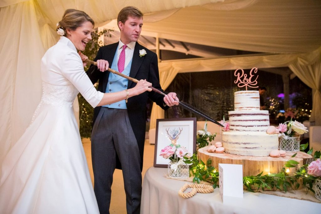 bride grooms cake cutting ceremony marquee reception blenheim palace woodstock oxfordshire oxford wedding photographer