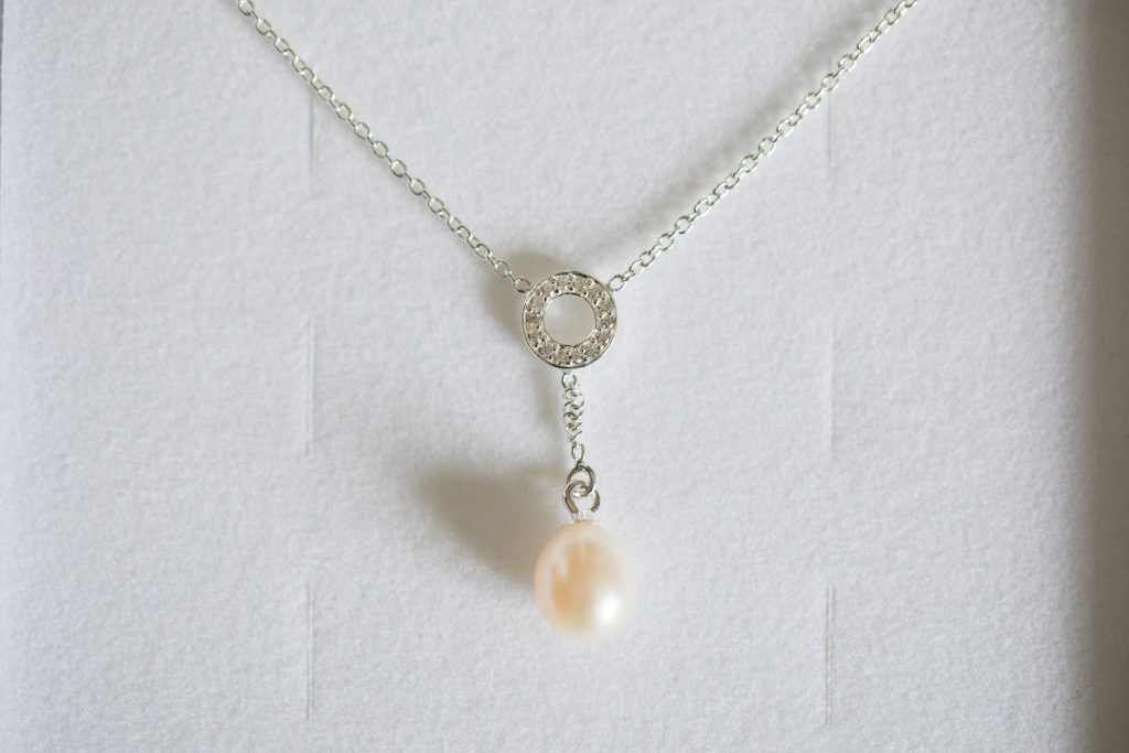 brides pearl necklace registry office roysse court abingdon oxford wedding photographer