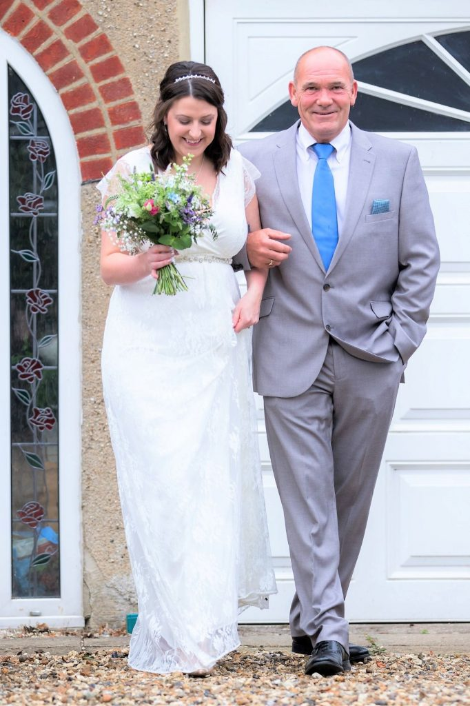 bride father of bride arm in arm registry office ceremony roysse court abingdon oxford wedding photography