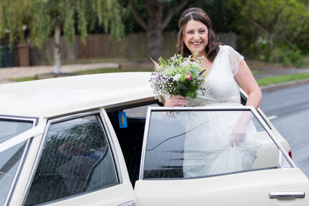 bride enters bridal car registry office ceremony roysse court abingdon oxfordshire wedding photographer