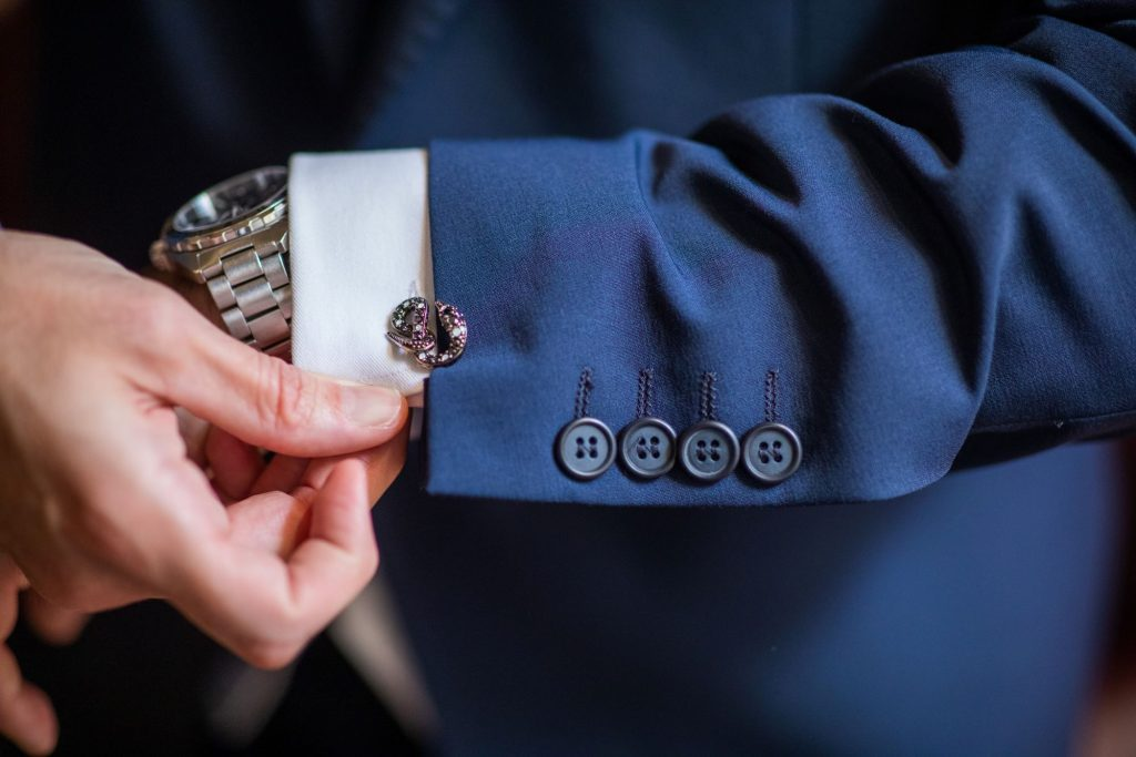 groom checks cufflinks lansdowne club marriage ceremony mayfair london oxfordshire wedding photographer