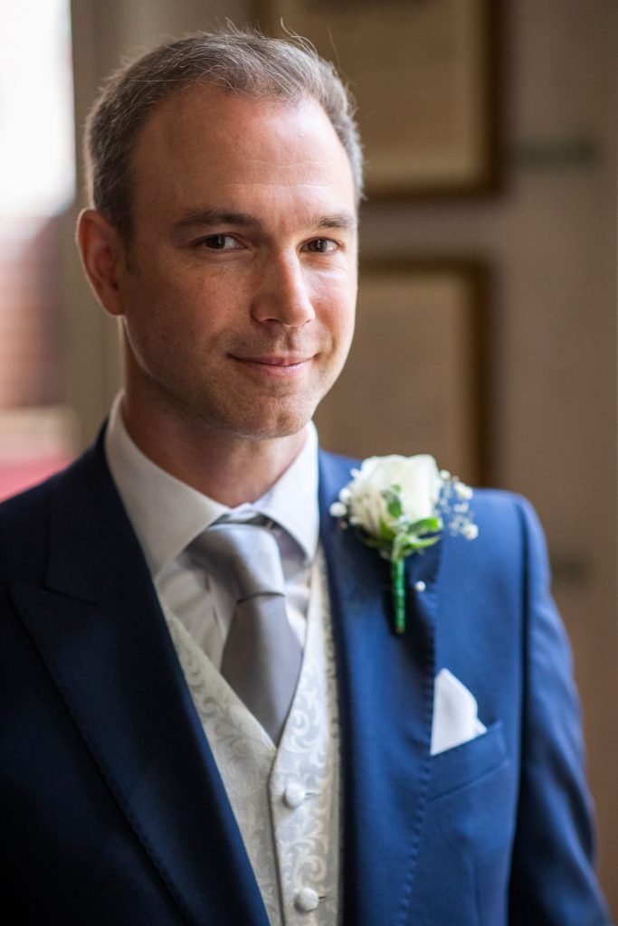 groom awaits bride lansdowne club marriage ceremony mayfair london oxfordshire wedding photographers