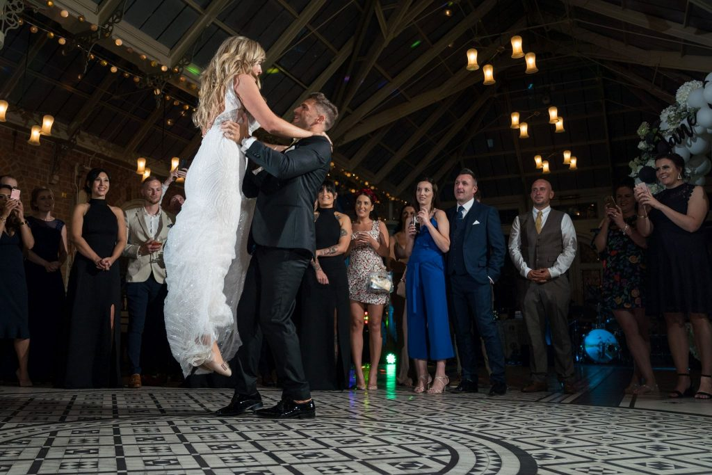 groom lifts bride first dance kilworth house hotel north kilworth leicestershire oxford wedding photographers