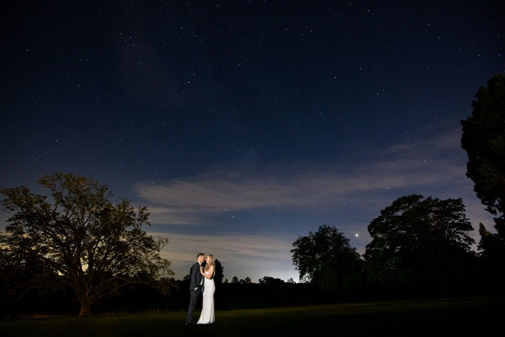 bride groom embrace beneath stars kilworth house hotel grounds north kilworth leicestershire oxford wedding photography