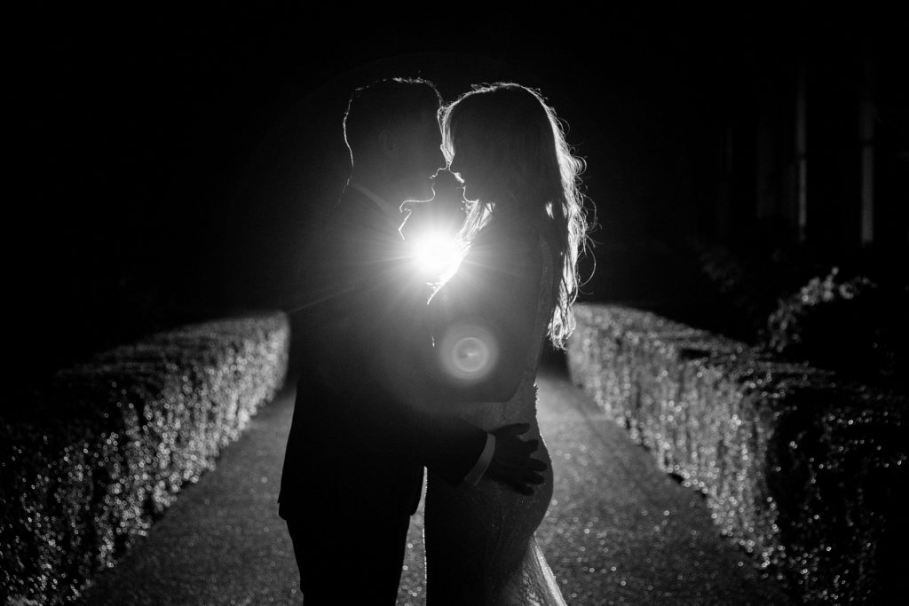 bride groom silhouette embrace kilworth house hotel north kilworth leicestershire oxfordshire wedding photographers