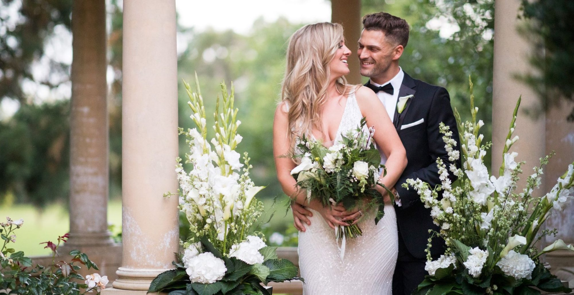 smiling bride groom floral arrangements kilworth house hotel gardens north kilworth leicestershire oxford wedding photographers