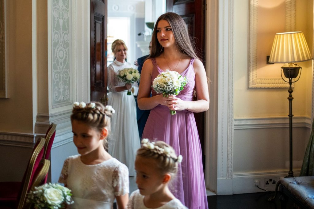 bridal party approach aisle lansdowne club marriage ceremony mayfair london oxford wedding photographer