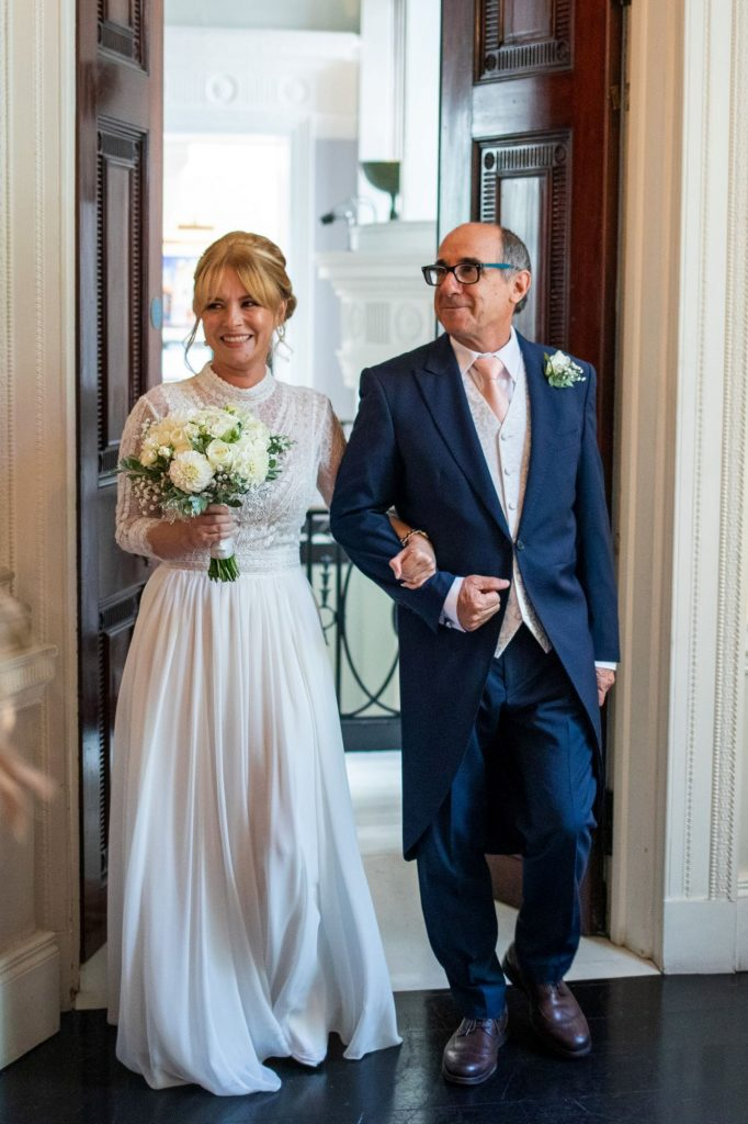 bride father of bride enter marriage ceremony lansdowne club mayfair oxford wedding photographers