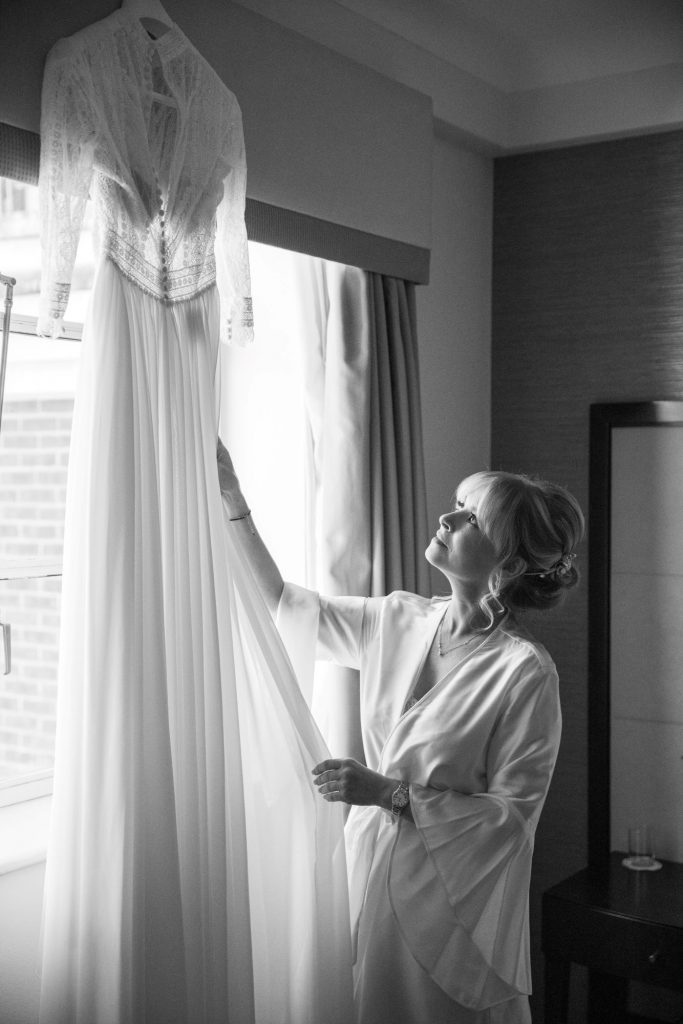 brides checks hanging dress bridal prep lansdowne club mayfair london oxfordshire wedding photographers