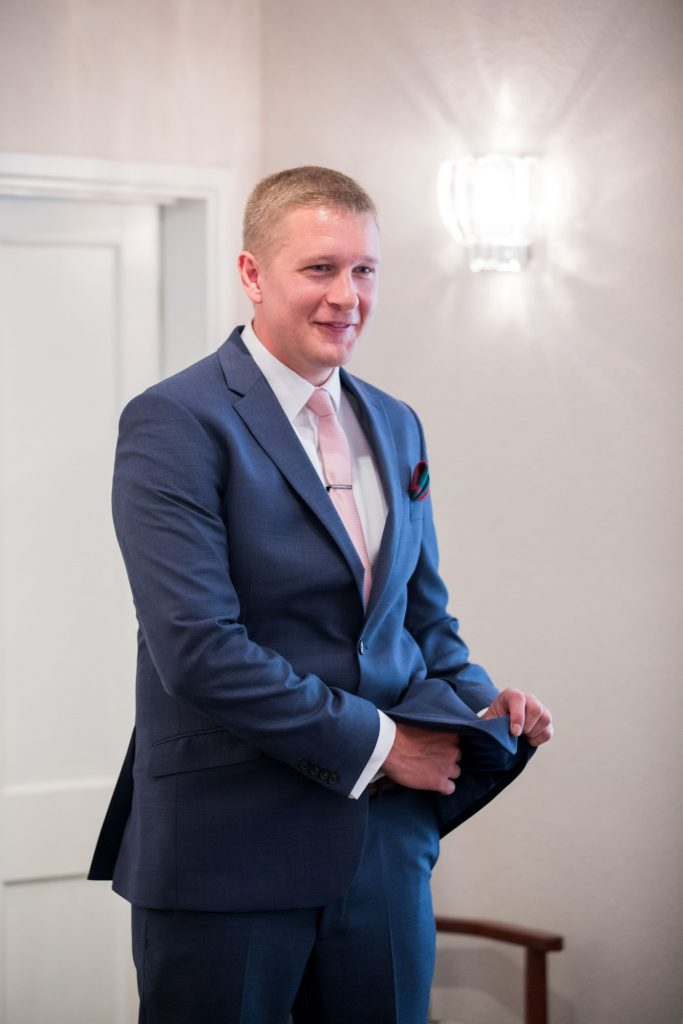 groom checks rings registry office ceremony roysse court abingdon oxfordshire wedding photographer
