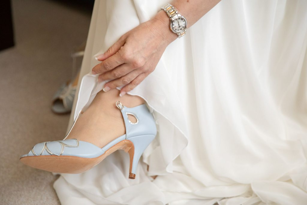bride fastens shoe bridal prep lansdowne club mayfair london oxford wedding photographer