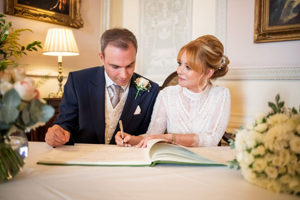 bride groom sign register lansdowne club mayfair london oxford wedding photographers