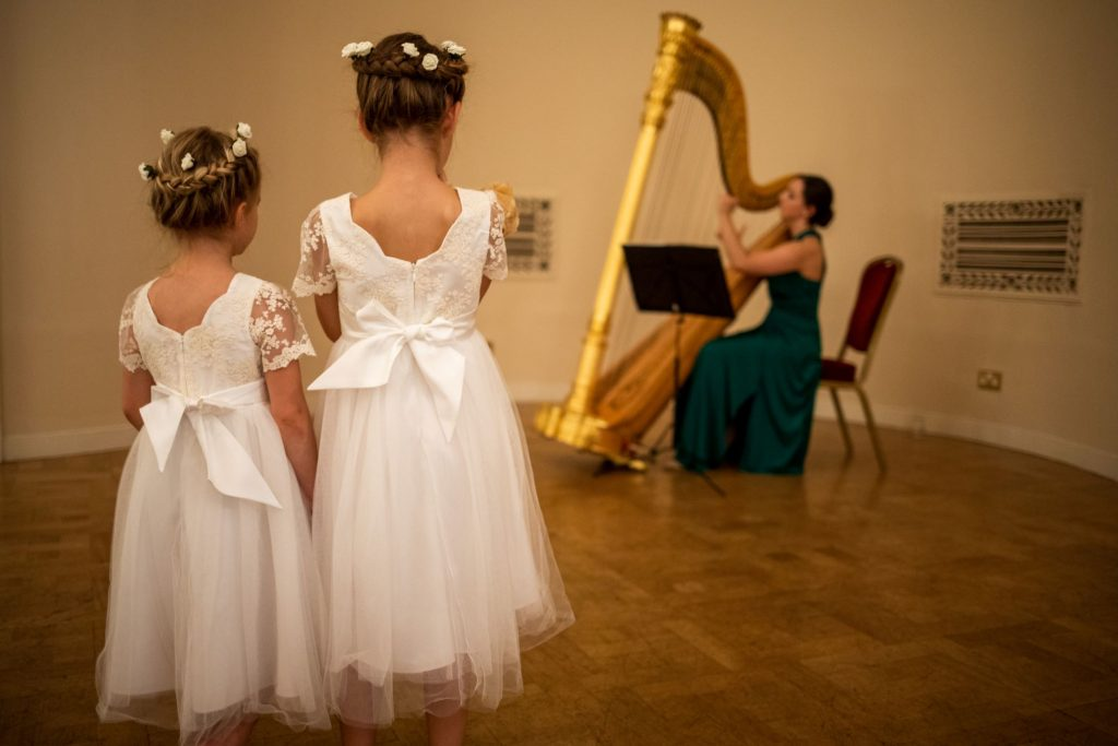 harpist plays flowergirls listen lansdowne club mayfair london oxfordshire wedding photographer