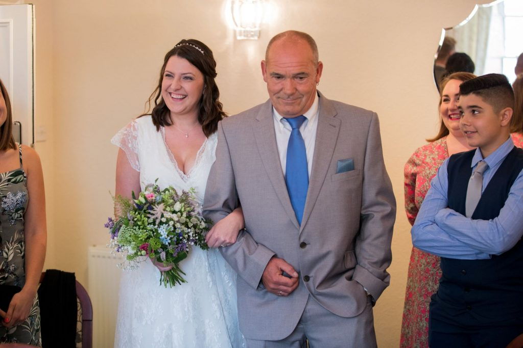 bride father of bride walk down aisle registry office roysse court abindgon oxfordshire wedding photographers